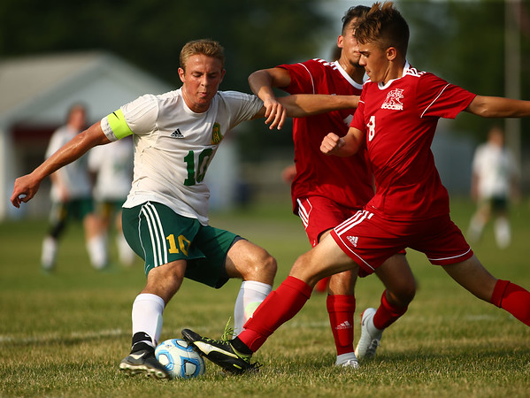 8-14-18<br /> Kokomo vs Eastern boys soccer<br /> Eastern's Lance VanMatre goes up against a couple Wildkats for control of the ball.<br /> Kelly Lafferty Gerber | Kokomo Tribune