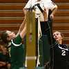 8-22-18<br /> Eastern vs Western volleyball<br /> Western's Karlyne Shepherd tips the ball over the net to Eastern's Morgan White.<br /> Kelly Lafferty Gerber | Kokomo Tribune