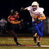8-24-18<br /> Taylor vs Tri Central football<br /> TC's Holden Rayl looks to outrun Taylor's defense.<br /> Kelly Lafferty Gerber   Kokomo Tribune