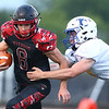8-24-18<br /> Taylor vs Tri Central football<br /> Taylor's Clay Brubaker runs the ball past TC's defense.<br /> Kelly Lafferty Gerber | Kokomo Tribune