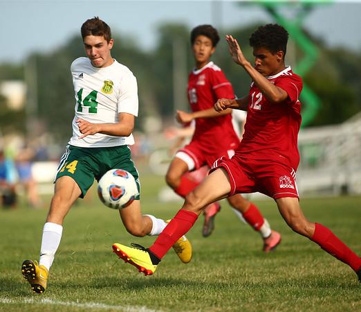 8-14-18<br /> Kokomo vs Eastern boys soccer<br /> Eastern's Evan Dean and Kokomo's Quincy Armstrong go after the ball.<br /> Kelly Lafferty Gerber | Kokomo Tribune