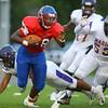 8-31-18<br /> Kokomo vs Marion football<br /> DeShawn Winson looks past Marion defense.<br /> Kelly Lafferty Gerber   Kokomo Tribune