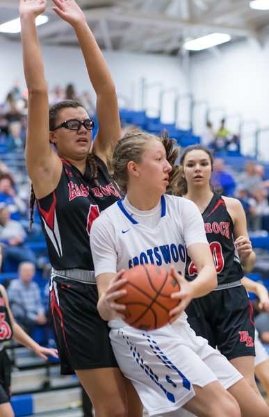 Naomi Gibson puts her hands up to discourage a shot from Stephanie Ouderkirk