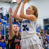Madisyn Forloines goes in for a shot