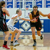Naomi Gibson drives in past Stephanie Ouderkirk