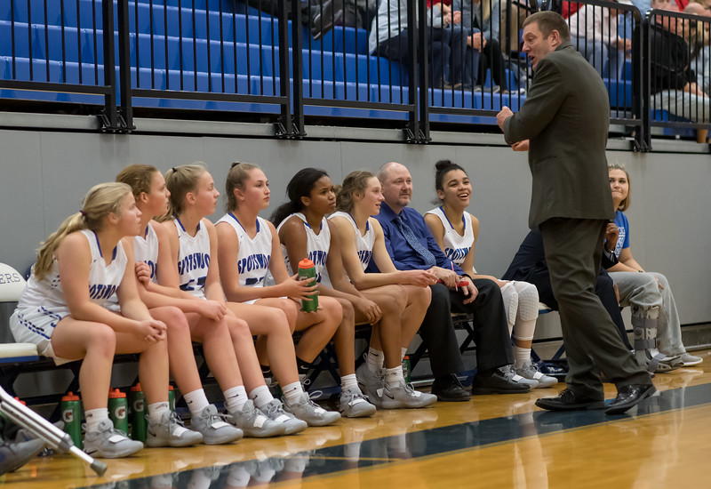 Coach Dodson shares some critique with his team on the bench