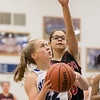 Kayci Carrier attempts a layup guarded by Alexis Brown