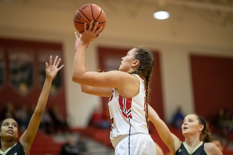 Naomi Gibson goes in for a shot