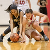 Naomi Gibson and Amaya Lucas both dive for a losse ball