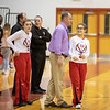 Coach Comer talks with Alexis Brown during warmups