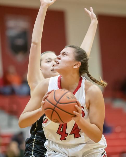 Naomi Gibson takes a shot under the basket