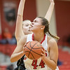 Naomi Gibson takes a shot under the basket