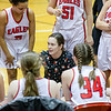 Coach Lam rallies her JV team during the closing seconds of their game