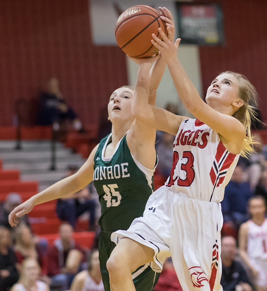 Mara Woolford gets a hand on a shot as Madison Voight goes for the layup