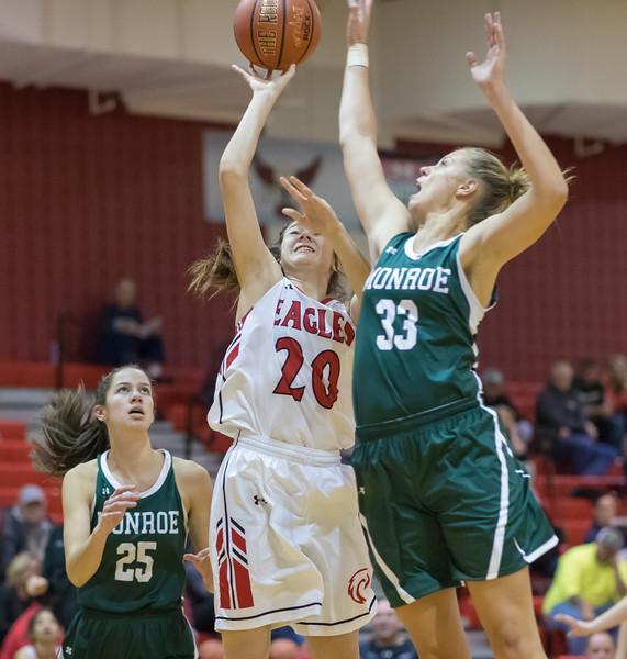 Samantha Brunelle tries to block a shot by Nicole Jefferson