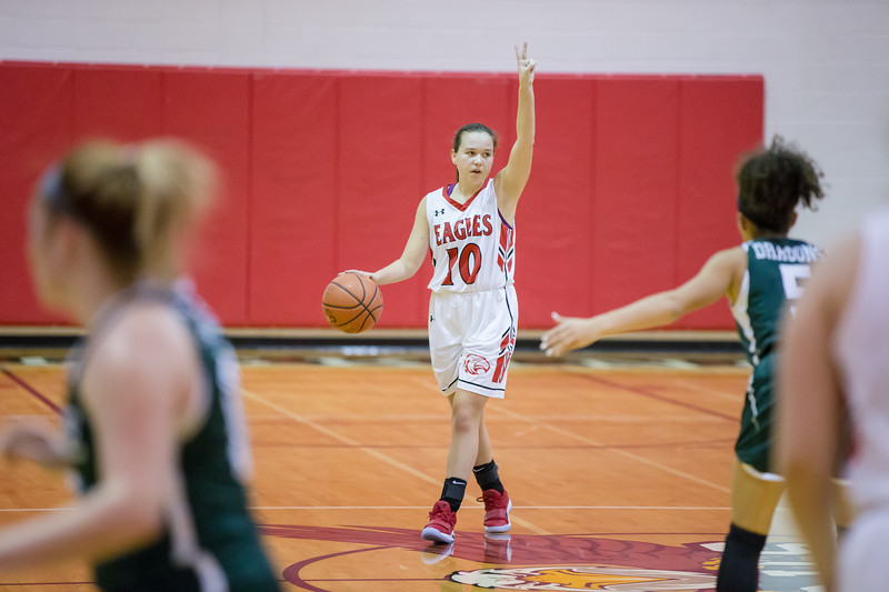 Erin Clayton calls the play as she brings the ball down court