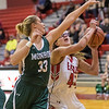 Naomi Gibson takes a look at a shot under the basket guarded by Naomi Gibson Samantha Brunelle