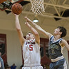 Tyler Nickel takes a shot under the basket with pressure from Max Kinsey