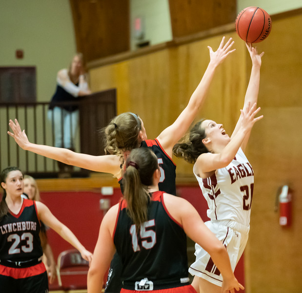 Rebecca Harvey puts up a shot under the basket