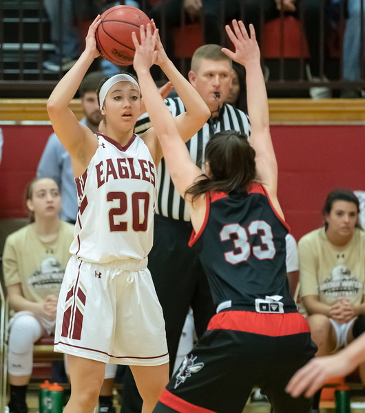 Briana Moore looks for an open teamate to pass to