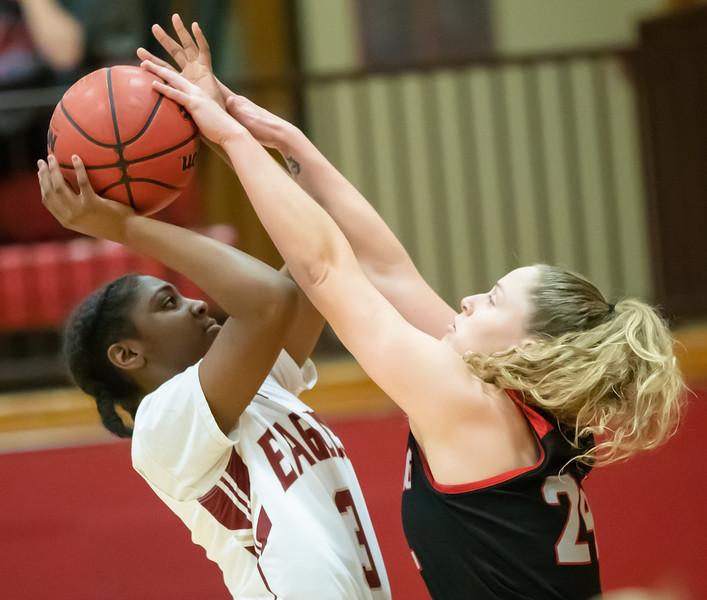 Makayla Johnson  takes a shot under the basket guarded by Alex Allen