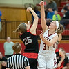 Allie Coburn (BC) and Erin Green  (Lyncburg) go for the jumpball