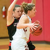 Claire Mocarski  tries to advance in towards the basket