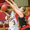 Makayla Johnson  takes a shot under the basket guarded by Alex Allen