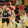 Allie Coburn  streaches to recover a loose ball