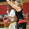 Makayla Johnson  turns to take a look at a shot under the basket