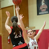 Claire Mocarski  tries to block a shot from Lizzie Davis