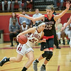 Briana Moore drives in by  Erin Green