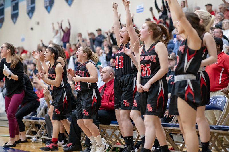 The Eagles beanch erupts after a three point shot from Sarah Smith