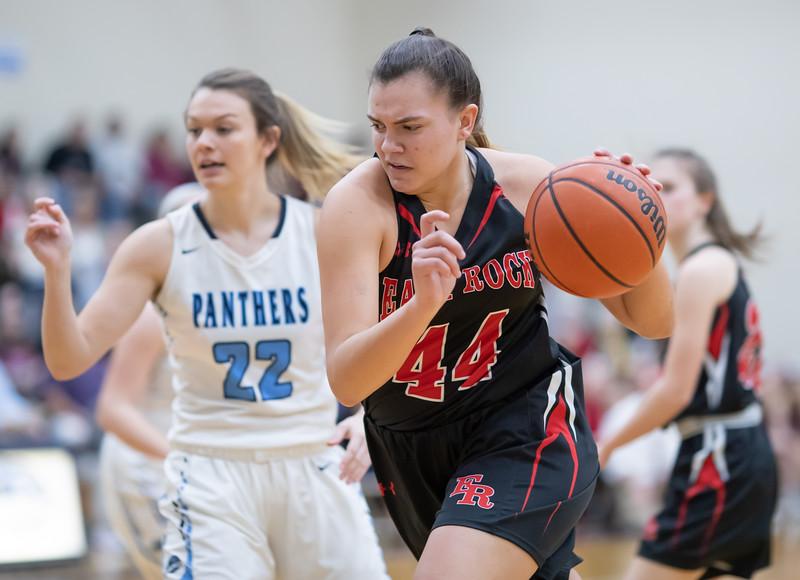 Naomi Gibson drives towards the basket