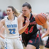 Naomi Gibson drives towards the basket