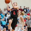 Alexis Baugher drives in for a layup