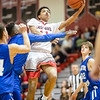 Tyce McNair comes in for a layup against Lee's Markqwan Miller