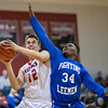 Eric Baylor powers his way to a shot against Markqwan Miller