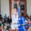 Tyler Nickel takes a jumpshot over Markqwan Miller