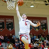 Tyler Nickel goes in for a dunk