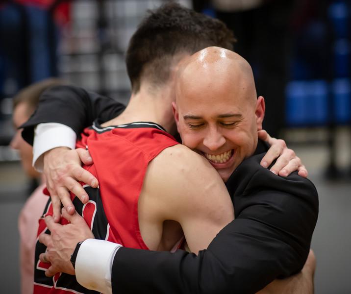 Coach Keyes hugs Dalton Jefferson after the game