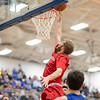 Collin WIgley goes up for a shot under the basket