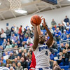 Elijah Mushagasha goes up for a shot under the basket.