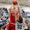 Tyler Nickel goes up for a shot over Connell Ischinger