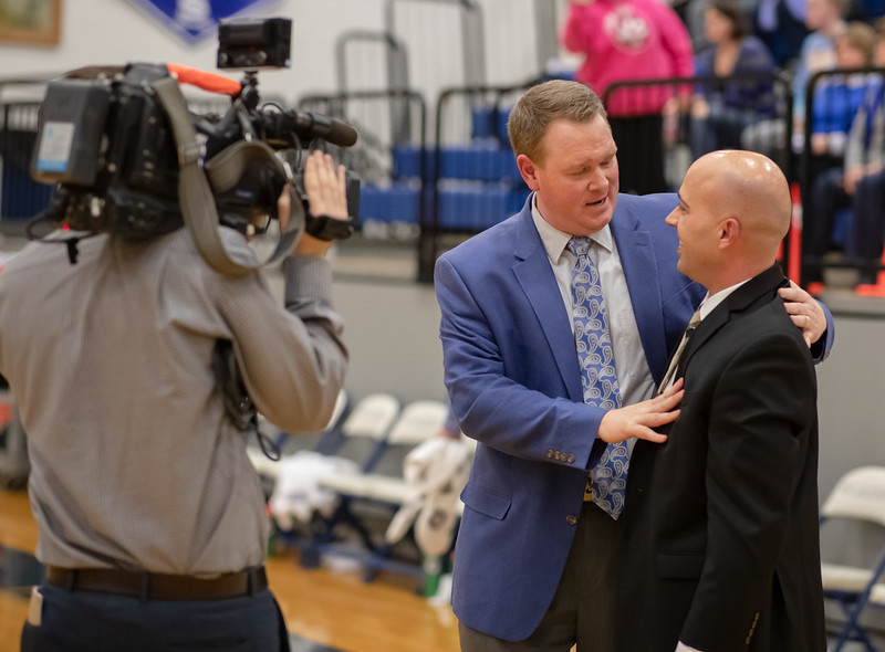 Coach Edwards and Keyes meet after the game