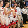 The Eagles bench celebrates Tyler Nickel's dunk
