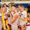 Issac Kisling kisses the Region Trophy