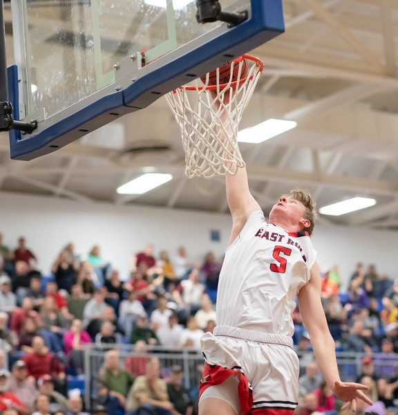 Tyler Nickel dives in for a dunk