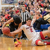 Griffen Morris slides to grab a loose ball