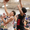 Issac Kisling gets a shot under the basket